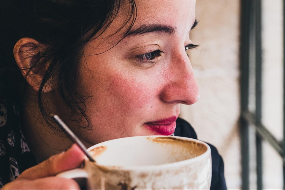 woman with coffee cup window